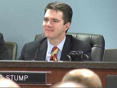 Pearce Bley/Cronkite News<br> Corporation Commissioner Bob Stump listens to testimony during a hearing on net metering.