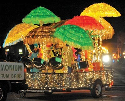 Matt Hinshaw/The Daily Courier, file<br> The Pandemonium Steel Drum Band float makes its way down Cortez Street  during the 2009 Holiday Lights Parade in downtown Prescott.