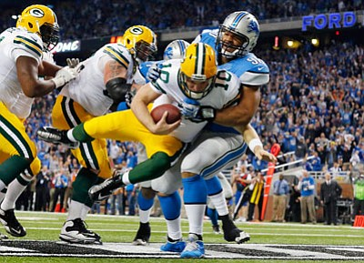 Paul Sancya/The Associated Press<br>Lions defensive tackle Ndamukong Suh sacks Packers quarterback Matt Flynn for a safety during Thursday's third quarter in Detroit.