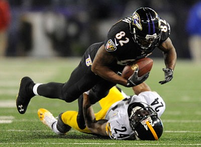 Nick Wass/The Associated Press<br>Ravens wide receiver Torrey Smith (82) is tackled by Steelers cornerback Ike Taylor during Thursday night's second half in Baltimore.