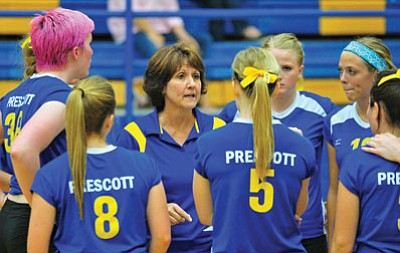 Matt Hinshaw/The Daily Courier<br>Prescott head coach Shellie Bowman instructs her players during a timeout against Flagstaff in their home opener back on Sept. 12, 2013.