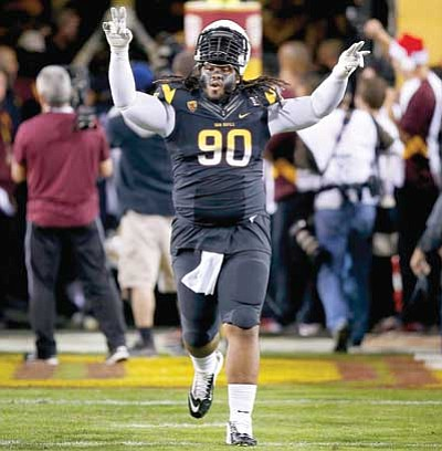 Ross D. Franklin/The Associated Press<br> Arizona State's Will Sutton runs onto the field before the game against Arizona on Saturday in Tempe. Arizona State defeated Arizona 58-21.