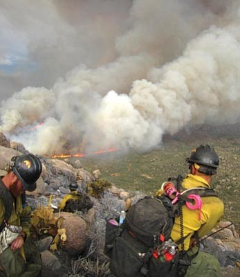Chris MacKenzie/Courtesy photo<br> The Granite Mountain Hotshots assess the Yarnell Hill fire June 30.