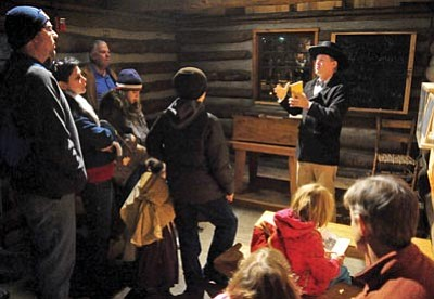 Matt Hinshaw/The Daily Courier, file<br>Samuel Rogers, played by Troy Groves, tells the audience about his schoolhouse during the 2012 Sharlot Hall Museum Frontier Christmas.