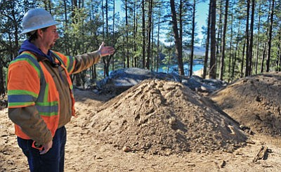 Matt Hinshaw/The Daily Courier<br> Brian Rainey, a supervisor with Fann Contracting, Inc., talks about the new ceremony pad, part of the Goldwater Lake expansion. The expansion is planned to be open early next year.