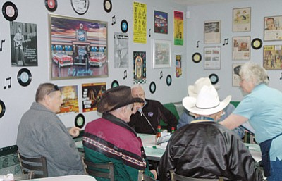 Patrick Whitehurst/The Daily Courier<br>  Customers get ready to eat at the '50s Diner and Backseat Bar in Cordes Junction.