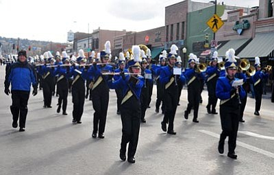 Matt Hinshaw/The Daily Courier<br>The Prescott High School marching band, seen here at this year's Christmas parade, benefits from tax credit donations