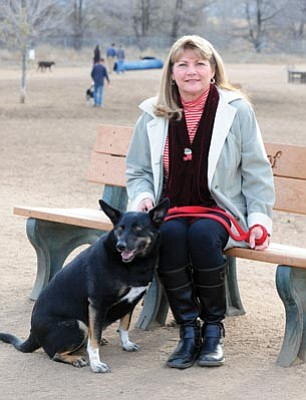 Les Stukenberg/The Daily Courier<br>Linda Nichols, who won the $500,000 Beneful Dog Park contest for the City of Prescott, sits at the dog park on Willow Creek Road with her dog Callie.