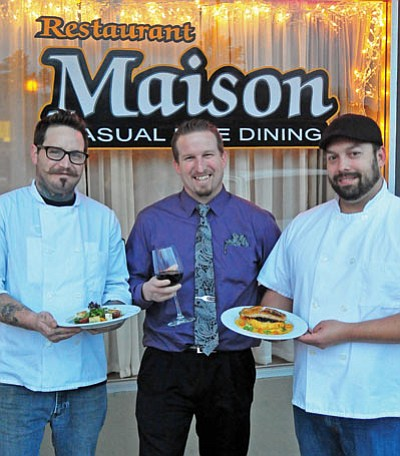 Matt Hinshaw/The Daily Courier<br> Owner and chef Adam Dagna, right, displays his Sea Bass with polenta cake, currant beet greens & arugula, with manager Charlie Knobbe, center, and Chef de Cuisine Harley Guy, displaying the Panzanella Salad, Wednesday night in Prescott.