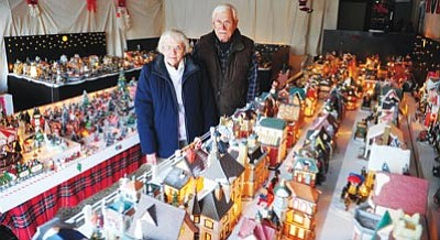 Les Stukenberg/The Daily Courier<br> First-place winners Delores and Bob Colstock have filled their garage with about 300 miniature Christmas- themed houses, a model railroad track and a flying Santa. They live at 8501 Posse Circle East in Prescott Valley and their display is open from 5-8:30 p.m. daily.