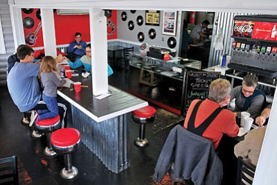 Matt Hinshaw/The Daily Courier<br> Patrons enjoy their lunches at Rock N Dog on Highway 89 in Prescott.