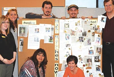 Courtesy photo<br>The Match Board at YBBBS shows the many matches from The Daily Courier Child of the Week column. Match advisors from left to right are Yivette, Brittany, Michael, Ian and Jim; kneeling are Laura and Lynn.