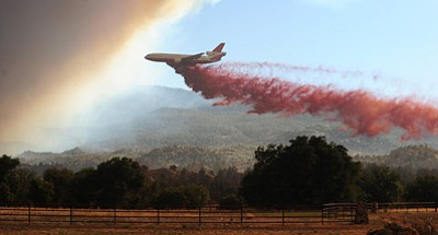 Les Stukenberg/The Daily Courier, file<br> A DC-10 heavy air tanker drops retardent along the  eastern side of Granite Mountain near American Ranch on June 18 as the Doce Fire burns its way down Granite Mountain.