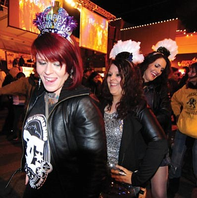 Les Stukenberg/The Daily Courier<br>Angie Murphy, Holly Whillock and Briana Woods dance the Macarena at the 3rd annual Boot Drop in downtown Prescott New Year's Eve.