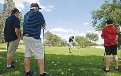 Les Stukenberg/The Daily Courier<br> Kody Riser tees off on the first hole of the North Course at Antelope Hills July 29, 2013.