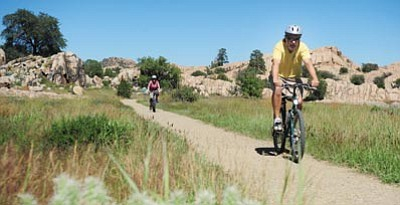 Les Stukenberg/The Daily Courier<br>Mike and Mary Olberding ride along the Willow Lake Trail in Prescott Sept. 23, 2013. The Olberdings moved here from Anchorage, Alaska, and said they were happy to have missed the 4 feet of snow that had recently fallen in their former hometown.