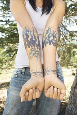 Photos.com<br>Tattoo ink is composed of different chemicals and dyes that can be highly toxic, yet little regulation exists to protect the consumer.