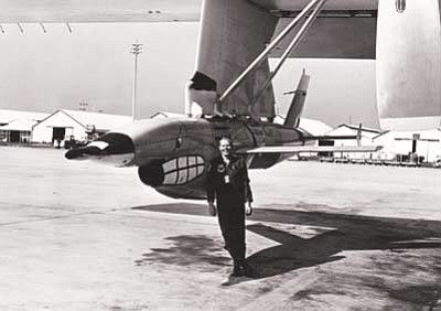 Courtesy photo<br>Col. John Dale in his active-duty days poses with a drone ready for action.