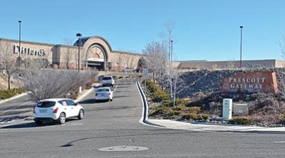 Matt Hinshaw/The Daily Courier<br>Vehicles enter the Prescott Gateway Mall parking lot Tuesday afternoon. Several stores recently renewed long-term leases.