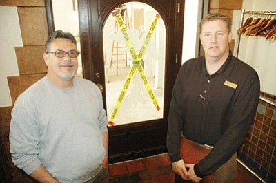 Patrick Whitehurst/The Daily Courier<br> Hassayampa Inn General Manager Michael Kouvelas and New Vista Builders President Lee Vega stand outside the entrance to the historic Peacock Room at Hassayampa Inn. Remodeling work, which began Jan. 2, is expected to finish in February. The room is scheduled to reopen Feb. 13, the day before Valentine's Day.