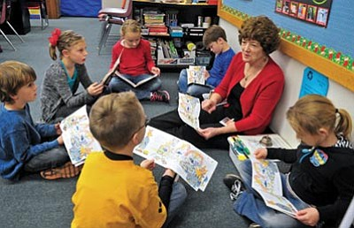 Matt Hinshaw/The Daily Courier<br> Abia Judd second-grade teacher Carol Yetman works with her students, from top, Jack Burton, Marah Murphy, Kennedy Carr, Cameron Hall, Dylin Sawicki, and Audrey Howell in a reading group Friday morning at Abia Judd Elementary School in Prescott.