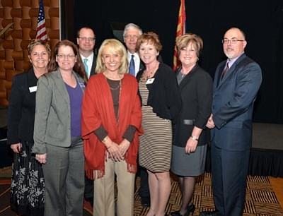 Courtesy photo<br>The Prescott, Prescott Valley and Chino Valley Chambers of Commerce hosted Gov. Jan Brewer during her annual visit to Prescott, where she shared her State of the State message. Pictured left to right are Chino Valley Chamber Board Chair Robin Christie, Chino Valley Chamber CEO Tracie Schimikowsky, Prescott Chamber Board Chair Ed Walsh, Gov. Brewer, Prescott Chamber CEO Dave Maurer, Prescott Valley Chamber Board Chair Jeri Ann Kooiman, Prescott Valley Chamber CEO Marnie Uhl, and Prescott Valley Chamber board member Steve Bracety.