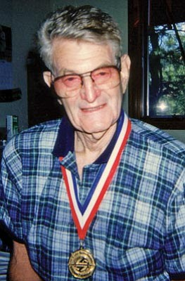 Courtesy photo<br>Lou Silverstein wears a gold medal that he won in one of the many masters championship swimming meets he competed in from the time he was a young man until he was in his 80s.