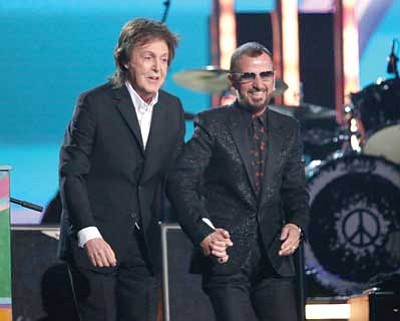 Matt Sayles/Invision/AP<br> Paul McCartney, left, and Ringo Starr take a bow after performing on stage at the 56th annual Grammy Awards at Staples Center on Sunday in Los Angeles.