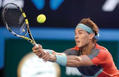 Andrew Brownbill/The Associated Press<br> Rafael Nadal, who's coming off a painful – literally – loss in Sunday's Australian Open men's final, is already in the lineup for the BNP Paribas Open March 3-16 in Indian Wells, Calif.