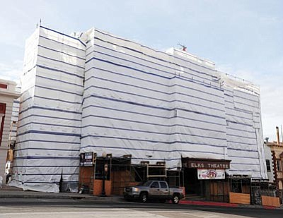 Les Stukenberg/The Daily Courier<br>The Elks Opera House is covered in plastic as workers restore deteriorating brick on the building's exterior.