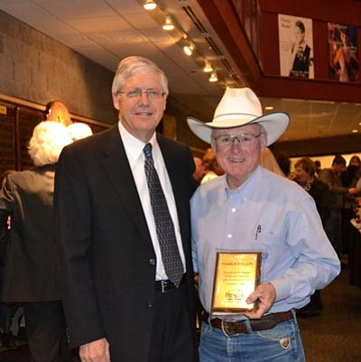 "Courtesy photo<br>Prescott Chamber of Commerce CEO Dave Maurer poses with Tommy Meredith of the Jersey Lilly Saloon, who was recognized for creating ""Friends of Jersey Lilly"" in 2008 to raise money annually for the Courthouse Lighting program."