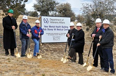 Matt Hinshaw/The Daily Courier<br>VA officials, project staff members, and architect and engineering firm representatives break ground for the new Bob Stump VA Medical Center mental health building Thursday in Prescott.