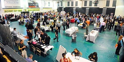 Les Stukenberg/The Daily Courier<br>Fifteen hundred job-seekers converged on the Yavapai College Gym in Prescott for a 2012 job fair.
