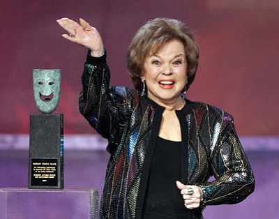 AP photo<br> In this Jan. 29, 2006 file photo, Shirley Temple Black accepts the Screen Actors Guild Awards life achievement award at the 12th Annual Screen Actors Guild Awards, in Los Angeles. Shirley Temple, the curly-haired child star who put smiles on the faces of Depression-era moviegoers, has died. She was 85.