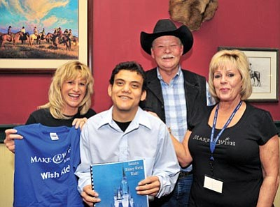 Matt Hinshaw/The Daily Courier<br>Lori Padilla, Frank Shankwitz and Debra Pauley with the Make A Wish Foundation pose Saturday at the Palace Saloon in Prescott with Isaiah Gunn, 17, after informing him his wish to go to Disney World is being granted.