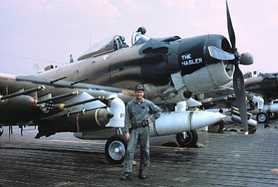 Courtesy photo<br>  George Marrett with a Douglas Skyraider in 1968. The jet fighter test pilot traded jets for these slower, armored planes when he became an Air Force rescue pilot in 1968.