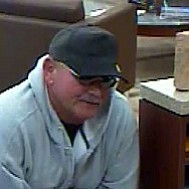 Courtesy photo<br> Bank video footage shows the robbery suspect believed to be Kevin Lee Campbell.
