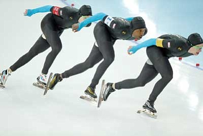 Pavel Golovkin/The Associated Press<br> The U.S. speedskating team – from left, Brian Hansen, Shani Davis and Jonathan Kuck – competes in the men's speedskating team pursuit quarterfinals at the Adler Arena Skating Center during the 2014 Winter Olympics in Sochi, Russia, Friday.