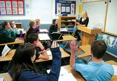 Patrick Whitehurst/The Daily Courier<br> Seventh and 8th grade math teacher Gwen Jahnke speaks to her students at the Christian Academy of Prescott. Approximately 130 students are currently enrolled at the downtown Prescott private school in preschool through 8th grade.