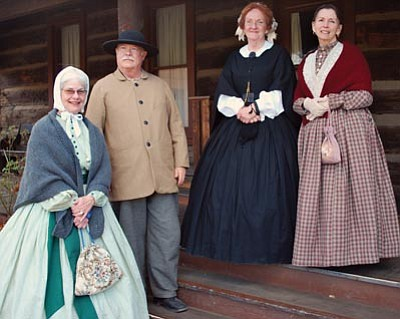 Joanna Dodder/The Daily Courier<br>Several Sharlot Hall Museum officials and volunteers wore 1860s clothing Thursday as the museum announced its sesquicentennial events. Pictured on the steps of the 1864 governor's mansion are, left to right, Lauren Looney, Mick Woodcock, Jennifer Bartos and Bi Sallomi.