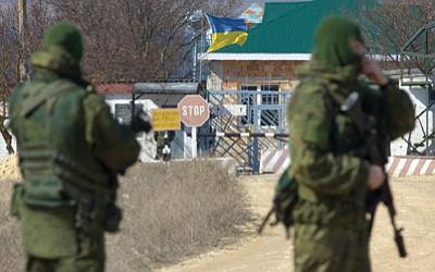 Ivan Sekretarev/The Associated Press<br> Pro-Russian soldiers block the Ukrainian naval base in the village of Novoozerne, west of Crimean capital Simferopol, Ukraine, on Monday.