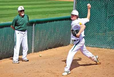 Matt Hinshaw/The Daily Courier<br>Yavapai College pitching coach Jerry Dawson watches Peter Lenstrohm warm up in the bullpen back on March 29, 2012, in Prescott.