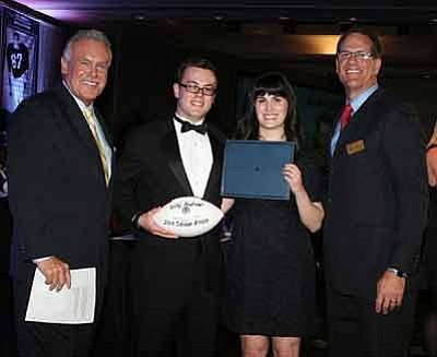 Courtesy photo<br>From left, ABC Channel 15 sports anchor Craig Fouhy, Willy Andrews, Willy's sister Lydia Goldman, and 1060AM's Dan Manucci honored Andrews at The Valley of the Sun Chapter of the National Football Foundation.
