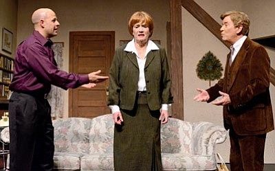 """Karen Despain/The Daily Courier<br>Bernard (Alastair Macdonald), left, puts his best friend Robert (John Bryan) and Suzette the cook (Linda Miller) squarely in the middle of his plot to deceive in """"Don't Dress for Dinner,"""" now playing on the main stage of Prescott Center for the Arts."""