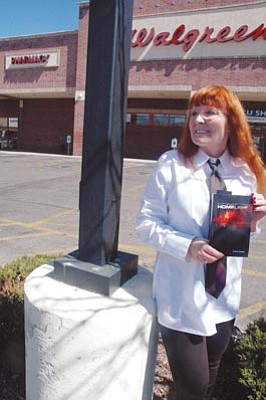 "Patrick Whitehurst/The Daily Courier<br>Paranormal fiction author Delena Epstein poses in the parking lot at the outdoor Prescott mall where she found the inspiration for her latest novel, ""Homeless."" The book focuses on a young artist  and her supernatural connection with a homeless woman."