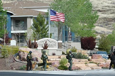 Cheryl Hartz/Prescott Valley Tribune/Courtesy photo<br> Prescott Valley Special Weapons and Tactics officers surround an apartment complex Wednesday morning after receiving a call about an alleged home invasion.