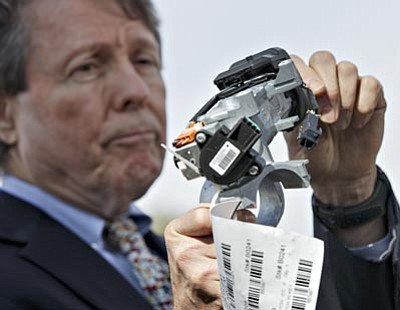 J. Scott Applewhite/The Associated Press<br> Clarence Ditlow, executive director of the Center for Auto Safety, displays a GM ignition switch similar to those linked to 13 deaths and dozens of crashes of General Motors small cars like the Chevy Cobalt, during a news conference on Capitol Hill in Washington, Tuesday.