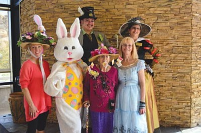 "Karen Despain/The Daily Courier<br /><br /><!-- 1upcrlf2 -->Guests, residents and Granite Gate Senior Living staff donned costumes for the ""Mad Hatter Tea Party"" fundraiser for Prescott Meals on Wheels Saturday. All decked out for the occasion are, front, guest Mary Van Gorder, the ""Rabbit"" activities director Ann Marie Wells, resident Virgina Eck (wearing a hat trimmed with tea bags), and marketing director Sharon Cucuzza dressed as Alice of ""Alice's Adventures in Wonderland."" In the back are ""Mad Hatter"" Will Burke, office manager and human resources director, and ""Queen of Hearts"" Marcia Turner, executive director of Granite Gate Senior Living."