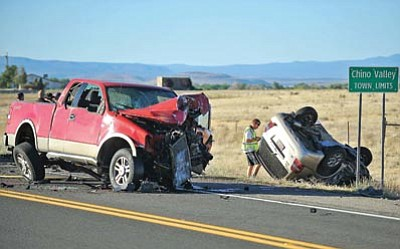 Matt Hinshaw/The Daily Courier, file<br> A member of the Chino Valley Police Department Accident Reconstruction Team inspects the scene of a double-fatal car wreck on Highway 89 just south of Chino Valley June 7, 2011.