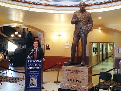 Catherine Calderon/Cronkite News<br>Secretary of State Ken Bennett unveils the statue of Barry M. Goldwater, which will be displayed at the Arizona Capitol Museum before it's shipped to Washington later this year.